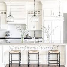kitchen island pendant lights a trio of corsica pendants illuminate an extra long kitchen island