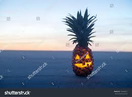 halloween pumpkin head jack lantern with burning candles over black background halloween on beach pineapple jack o stock photo 153443627