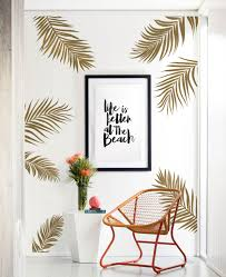 fun in the sun favorites wall decals and wallpaper simple shapes summery palm leaves wall decals w5027 in gold are applied on the wall around
