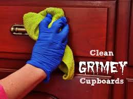 cleaning kitchen cabinets wood cleaning grimy wood kitchen cabinets can be tricky because of grease