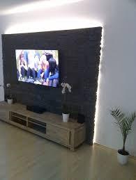 steinwand wohnzimmer tv die besten 25 steinwand wohnzimmer ideen auf tv wand