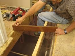 level an uneven crowning subfloor by planing sanding joists