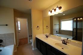 bronze bathroom light fixtures oilrubbed bronze light above mirror