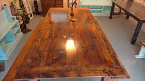 red oak stained dining table with four benches tabula rasa