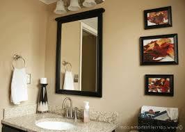 man bathroom decor light brown drawer fringed red blanket white