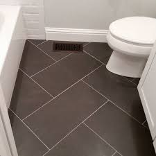 bathroom floor idea wide plank tile for bathroom great grey color great option if