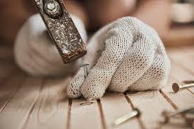 hardwood floor refinishing repairs offering laminate flooring