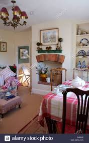 pink checked cloth on table in cottage dining room with small
