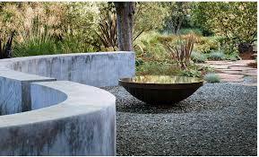 v small reflecting pool with low wall surrounding bernard trainor