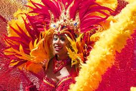 carnival brazil costumes woman wearing yellow pink costume free stock photo