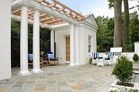 pool house addition on raised terrace creates stunning outdoor