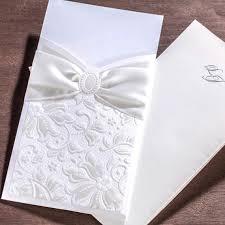 embossed wedding invitations 50 white bow embossed wedding invitations with envelopes