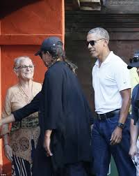 malia and sasha obama don colorful yellow sarongs in bali daily