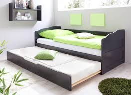 black painted pine wood daybed with lime green bed comforter of