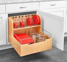 kitchen cabinet drawer peg organizer there s now a built in tupperware organizer you can get for