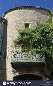 tower house with elegant decorative iron balcony pezenas herault
