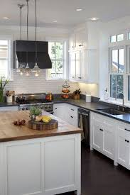 white cabinets with butcher block countertops white cabinets black counter top subway tile love it home