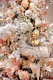 beautiful ballerina doll on a ballet themed christmas tree by
