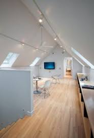 Lighting Vaulted Ceilings Track Lighting Installed To Wash The Vaulted Ceiling With Light