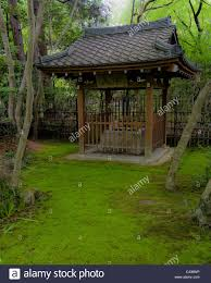 small well house with a traditional japanese roof stock photo
