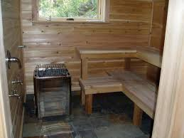 a sauna in the basement cedar walls and benches slate floor