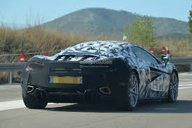 camo mclaren mclaren 570s spied testing with ferrari f12berlinetta as benchmark