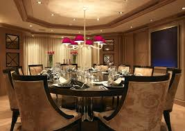 luxury dining room with patterned chair and round pedestal dining