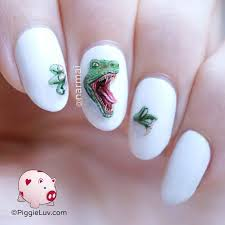 piggieluv freehand raptor nail art