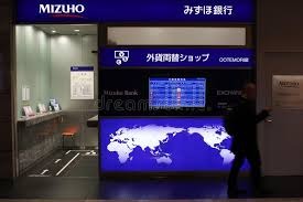 a mizuho bank currency exchange bureau in a central subway