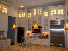 kitchen cabinets to light stacked cabinets staggered for visual interest glass