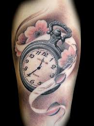 clock tattoo on hand want this could set time to when child was born or when a loved