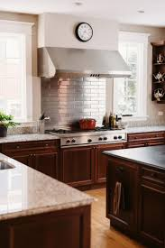 39 best professional kitchen design images on pinterest a sleek stainless steel subway tile backsplash is a nice complement to the stainless steel cooktop design kitchenkitchen