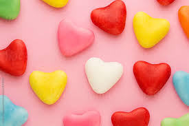 heart shaped candy various heart shaped candy on a pink background by kaat zoetekouw