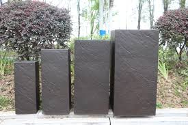 outdoor tall square planters with custom rock materials design