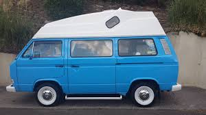 volkswagen blue blue and white vw hightop t25 vanagon with steelies camping