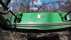 clearing underbrush with john deere 3038e and d160 loader youtube