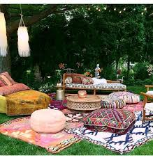 outdoor bohemian party with moroccan rugs and textiles designed