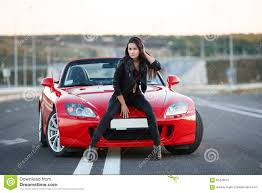 sport cars with girls near red car stock photo image 65426537