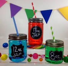 12 clear 17oz plastic mason jars with daisy cut lids