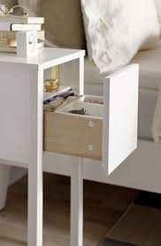 white narrow bedside table with four drawers perfect for when