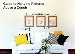 proper height to hang pictures on wall easy tips to hang pictures above a couch utr déco blog