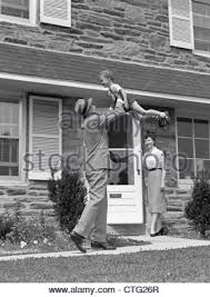 1950s Home 1950s Father Man Coming Home Kneeling Arms Extended Boy