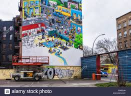 artist on scissor lift painting full wall mural advertisement aktion mensch charity supports barrier free living artist on scissor lift painting full wall