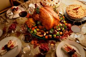 thanksgiving meals featuring turkey and pie on dining table