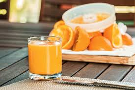 drink table selective focus photography of pure orange juice free stock photo