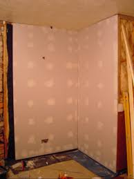 damp proofing a basement by adding a damp proof membrane dpm