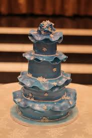 whimsical blue ruffle wedding cake with white floral detail