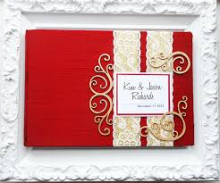 ivory wedding guest book and gold wedding guest book with swirl embellishments made to