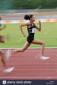 blurred colourful motion and action of track and field events 100m