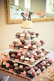 cupcake tower wedding ivory blush pink cupcakes in madagascan